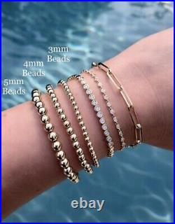 14 Karat Yellow Gold 5mm Bead Bracelet Stretchable Brand New With Pouch And Tag