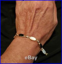 14k Gold 8.1 Grams Mother Of Pearl & Onyx Bracelet designer is WRE