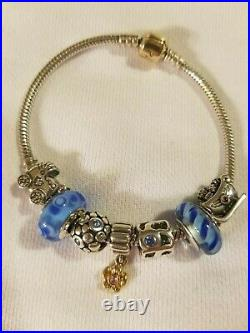 Authentic Pandora silver bracelet, gold clasp, including charms- pre-owned