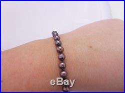 Fine black cultured pearl 18ct gold clasp bracelet