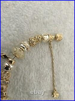 Genuine Pandora Bracelet with 14 kt Gold Safety Chain and 21 Charms