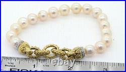 Heavy 18K gold beautiful. 28CTW VS1/F diamond 8.5mm pearl strand bracelet