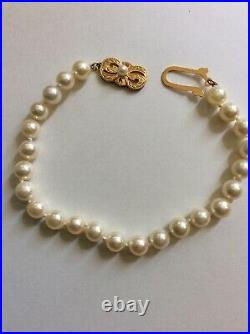 MIKIMOTO pearl bracelet with 18 k. Yellow gold clasp. 6-6.5 mm pearls. EUC