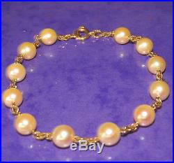STUNNING SECONDHAND 18ct YELLOW GOLD PEARLS LINE BRACELET19. Cm