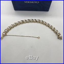 Vintage authentic Mikimoto 14k yellow gold pearl link scallop bracelet circle