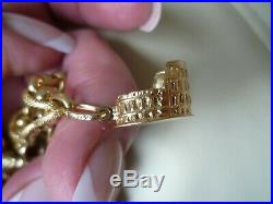 Vtg. Italy 18k Gold Link Bracelet with 18k and 14k Yellow Gold Charms, 33.3 gr